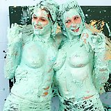 Two naughty slutty babes getting messy with lots of paint