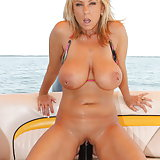 Watch this whore fuck herself with big toys while out on her boat. Naughty Alysha