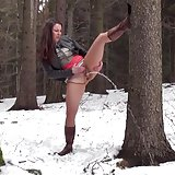 Hot brunette nearly pisses herself in the snow