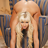 Gorgeous blonde babe Cindy Dollar getting naked showing all