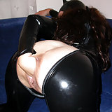 Vaginal Self Fisting In a latex catwoman outfit i fist myself on the couch. Catwoman gives hereself the paw.