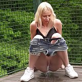 Blonde babe Carol Lilien sprays her warm piss over decking