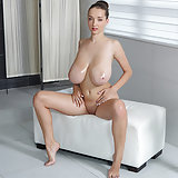 Busty Buffy pleases herself with oil massage. Lucie Wilde