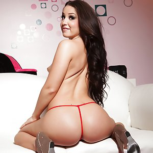 Sexy Teen Lola Foxx on a white couch