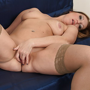 Naughty mom playing with herself on the couch