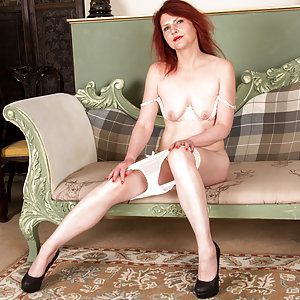 Mature and horny, Cee Cee is ready for action anytime, anywhere. She's always happy to peel off her miniskirt and sheer panties and bra, baring herself for the touch of her soft hands on her hanging all naturals, followed by the caress of her palms along her silky bare cunt.