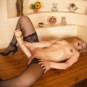 Horny housewife getting wet and wild in her livingroom