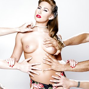 Blonde beauty Carter Cruise, elegantly puffing a cigarette in pearls, painted red lips and a 1940s 'do, recruits a quartet of rough neck working stiffs to defile her in a circle suck. Aggressively she sways her ass in a thong, telling the dudes to stroke their dicks. Chad Diamond, Filthy Rich, Chad Alva and Eric John surround her, cock-slapping her gorgeous face. Stroking, sucking and spitting on four big boners trashes her refined make-up. Carter deep-throats and laps balls. The lucky bastards get rough, choking her and stuffing her mouth with multiple pricks at once. 'Finish me off!' she bellows as Chad eats her hairy bush, and it's orgasms all around. Face bathed in cum, a suddenly sober Carter barks, 'You guys need to get the fuck out.'