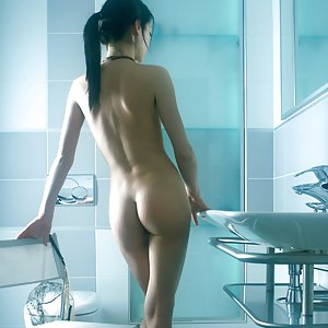 Small breasted beautiful asian lassie Katya F aka Yumyko posing in the bathroom showing her slender nude body.