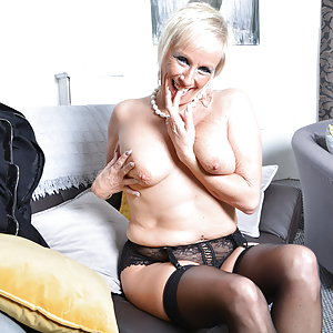 Naughty British housewife Debbie playing with her pussy