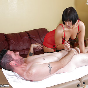 Masseuse Rose Rhapsody stroking her clients cock until it spurts out a pathetic amount of goo.