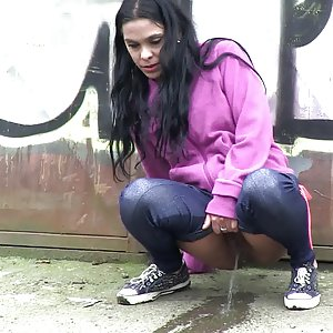 Pretty black haired girl leaves a piss puddle