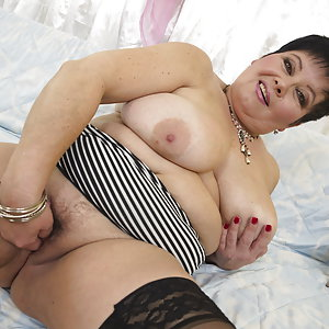 Big breasted mature BBW playing alone