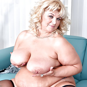 Naughty big breasted mama playing with her toy