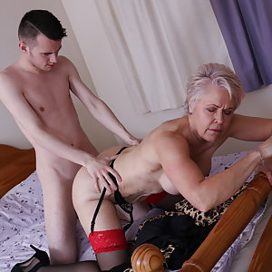 Horny mature lady fooling around with her toy boy