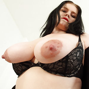 Naughty mom showing off her big tits
