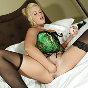 OMG!! Look how hot this blonde is dressed to kill in her sexy green corset. HOTT !!