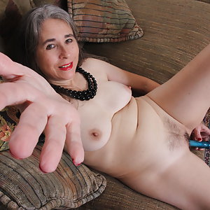 Naughty unshaved mature lady playing with herself