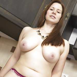 Curvy mom Carol Wings playing in the kitchen