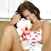 Young Claudia enjoys playing with her favorite toys and showing off her beautiful nude body.