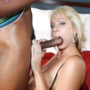 This slutty blonde goes to town on a nice black cock.