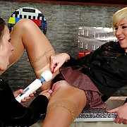 Hot brunette babe teases a horny blondes pussy with toy