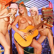 Three young girls having fun with vibrators and their tongue